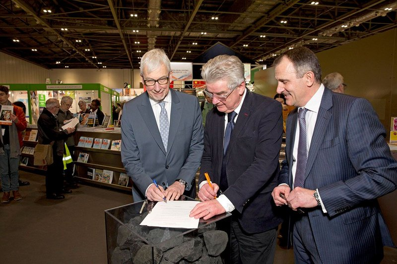 Designing processes for safer buildings: RICS president John Hughes, RIBA president Ben Derbyshire and CIOB past president Paul Nash sign the Joint Memorandum of Understanding.