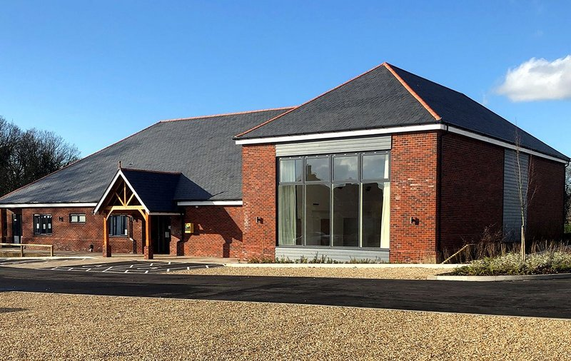 The village hall at Thakeham with Cupa Pizarras Cupa 12 natural slate roofing. The dark grey slate has thin laminations, a smooth surface and can be split to an average thickness of 3.5mm, 5mm and 6mm.