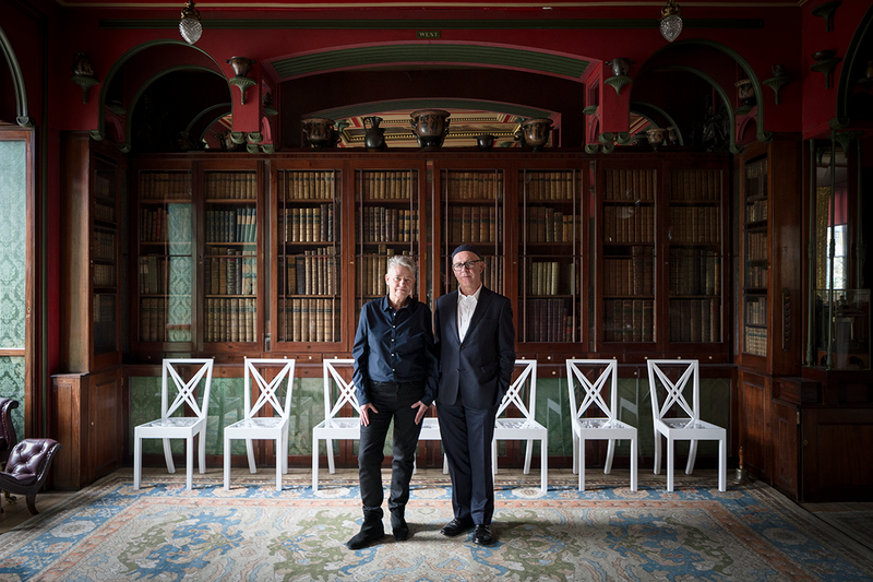 Langlands & Bell in the Library Dining Room at Sir John Soane's Museum with their artwork Grand Tour 2020 in the background, from Langlands & Bell - Degrees of Truth.