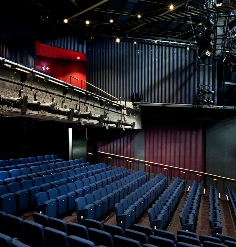 In the auditorium, seating is rearranged with a steeper rake.