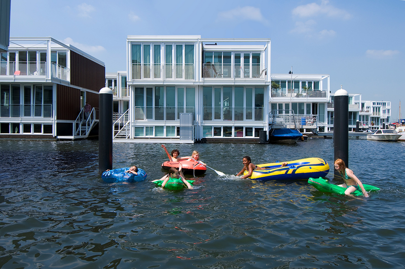 Floating homes in IJburg on the edge of Amsterdam harbour, designed by Marlies Rohmer.