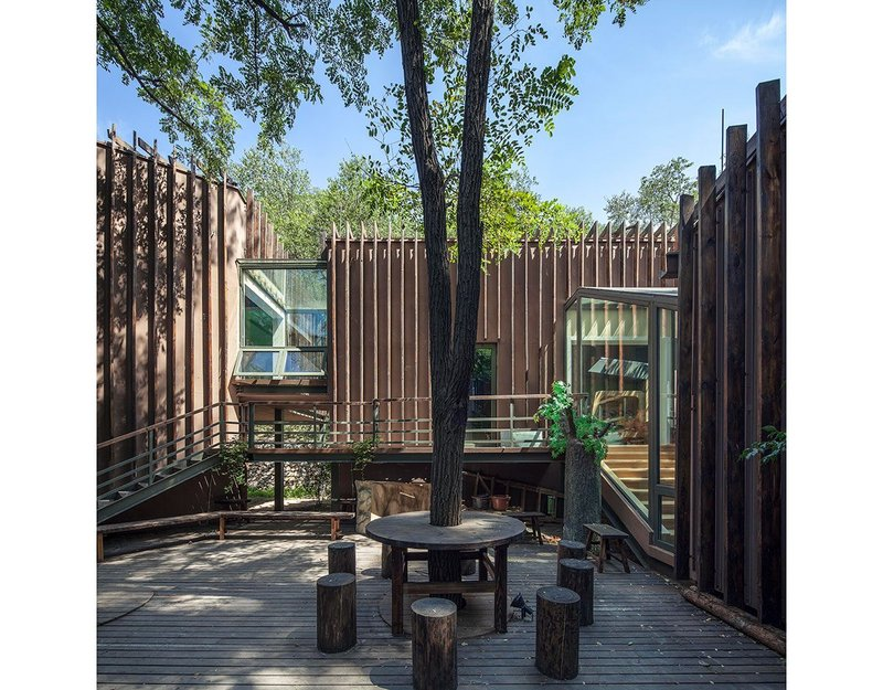 Badaling Forest Experience Center, Beijing. Colours were chosen that were similar to the trees and soil to help the building blend into its setting. Photo: Zhangyong. © Courtesy of BCKJ Architects