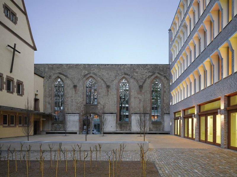The nave wall of the original Hospitalkirche forms one side of the re-instated and longer courtyard. The west face of the remaining church is planned to have huge glazed openings, bringing it too into the courtyard fold.
