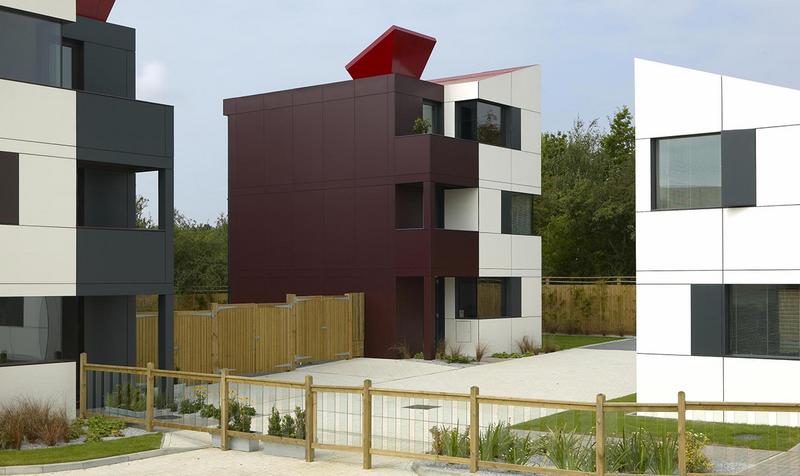 Trespa Meteon facade cladding in 11 shades at Oxley Park housing, Milton Keynes.