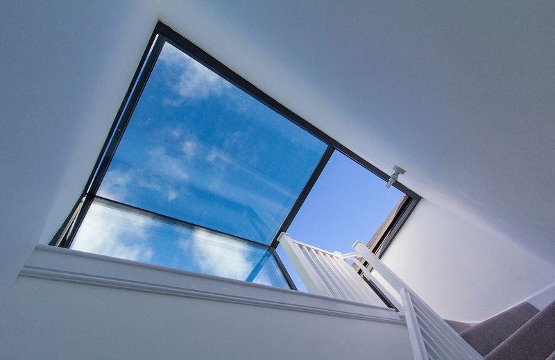 Stairwell leading to box rooflight access