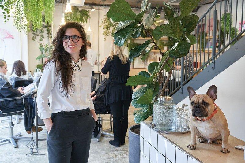Intervention Architecture's director Anna Parker in the Hazel + Hayden hair salon she designed.