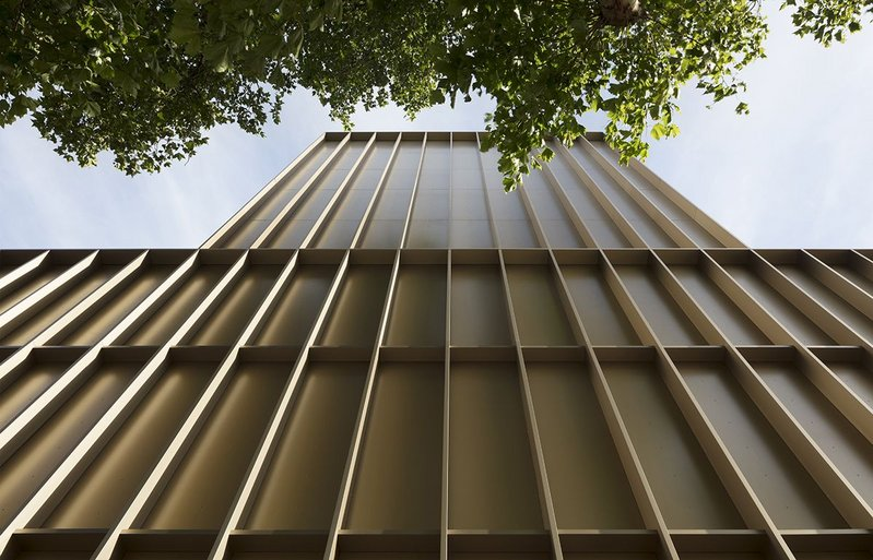 Fine exercise in articulation of a black-box facade in bronze-finish anodised aluminium – the colour is called pale umber.