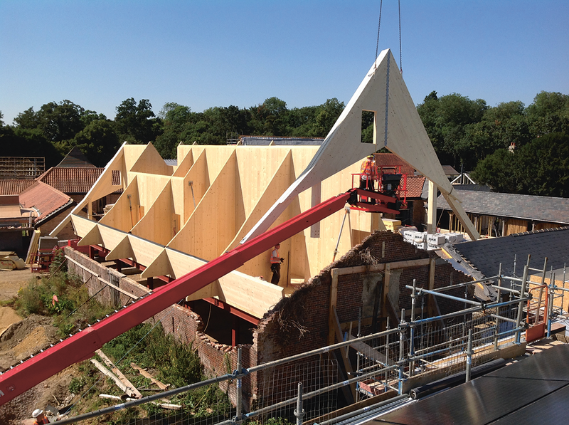 Digitising an existing barn allowed new insertions to be accurately modelled. Here a CNC-cut CLT element fabricated off-site to fine tolerances is lifted into the barn at Anstey Hall, Cambridge, avoiding complex temporary works and breathing new life into the heritage structure.