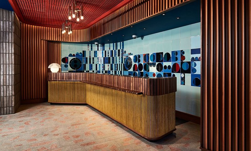 Timber slats and geometric tiles set the scene in the hotel's reception.