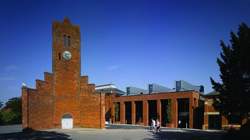 Brick contextualism: new mixed-use building works with its neighbours.