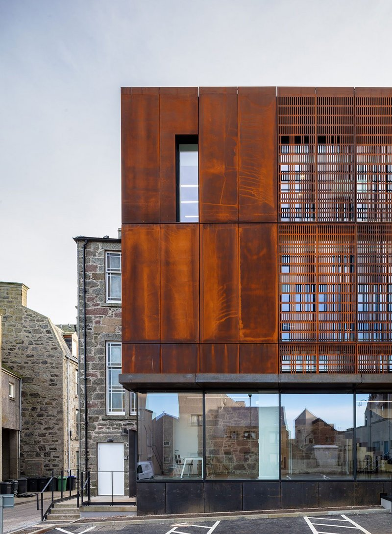 The Corten and glass outer skin is like a carapace over the old; translucent in parts to allow the existing to be read past the new.