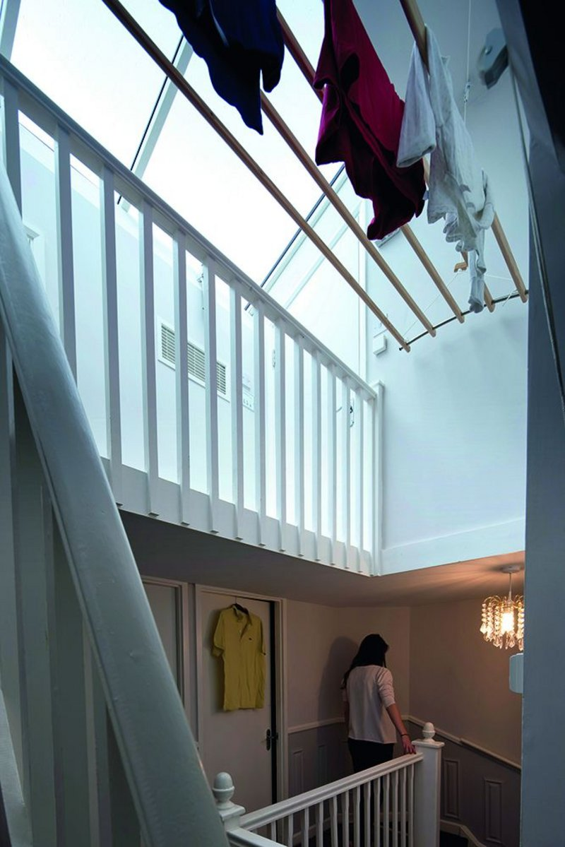 A Dutch airer instead of a tumble drier in the new attic level gives an immediate saving in running costs.