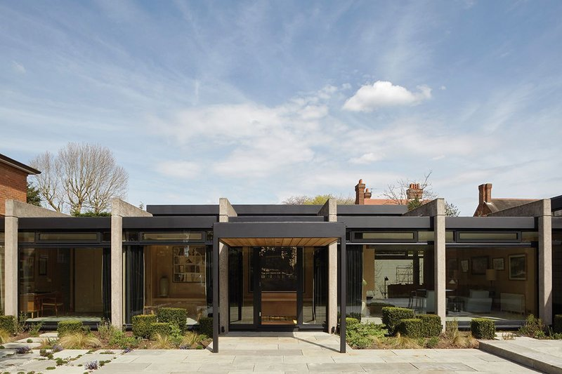 Giles & Pike's refurbishment included a complete replacement of the floor to ceiling glazing, which sits behind the modernist house's distinctive portal frame.