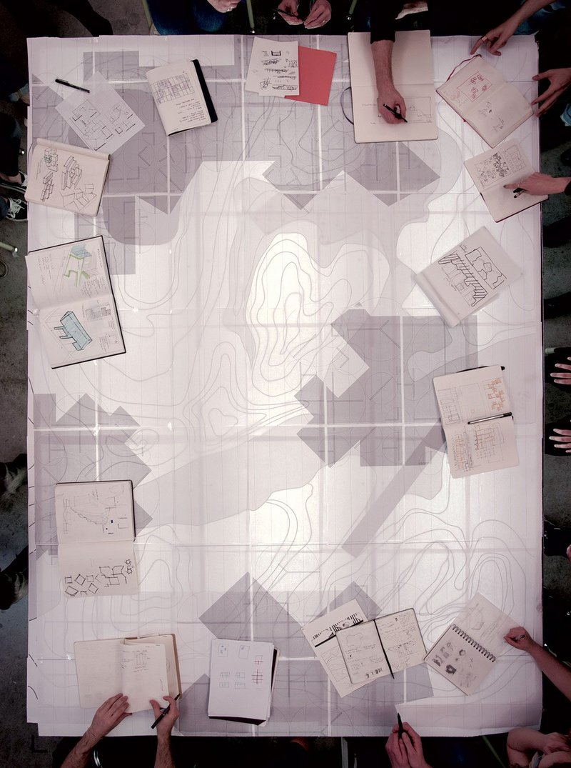 Day 3: Aerial view of one of our gatherings around the table surface with work-in-progress by two of the four ensembles, showing 'Land' and 'Rooms' overlayed into one topography.