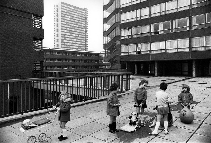 Tony Ray Jones, Pepys Estate, Deptford, London: children playing on a raised walkway, 1970.