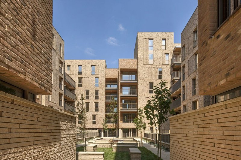 Royal Road housing with an attempt by Panter Hudspith to give more identity to the surfaces and spaces.