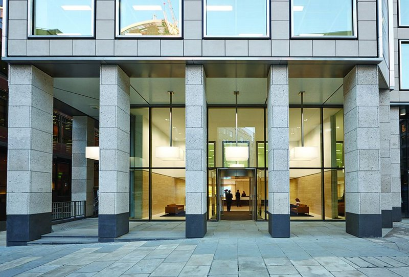 The entrance loggia  is clad in shell-rich Portland stone and incorporates access to the re-routed High Walk.