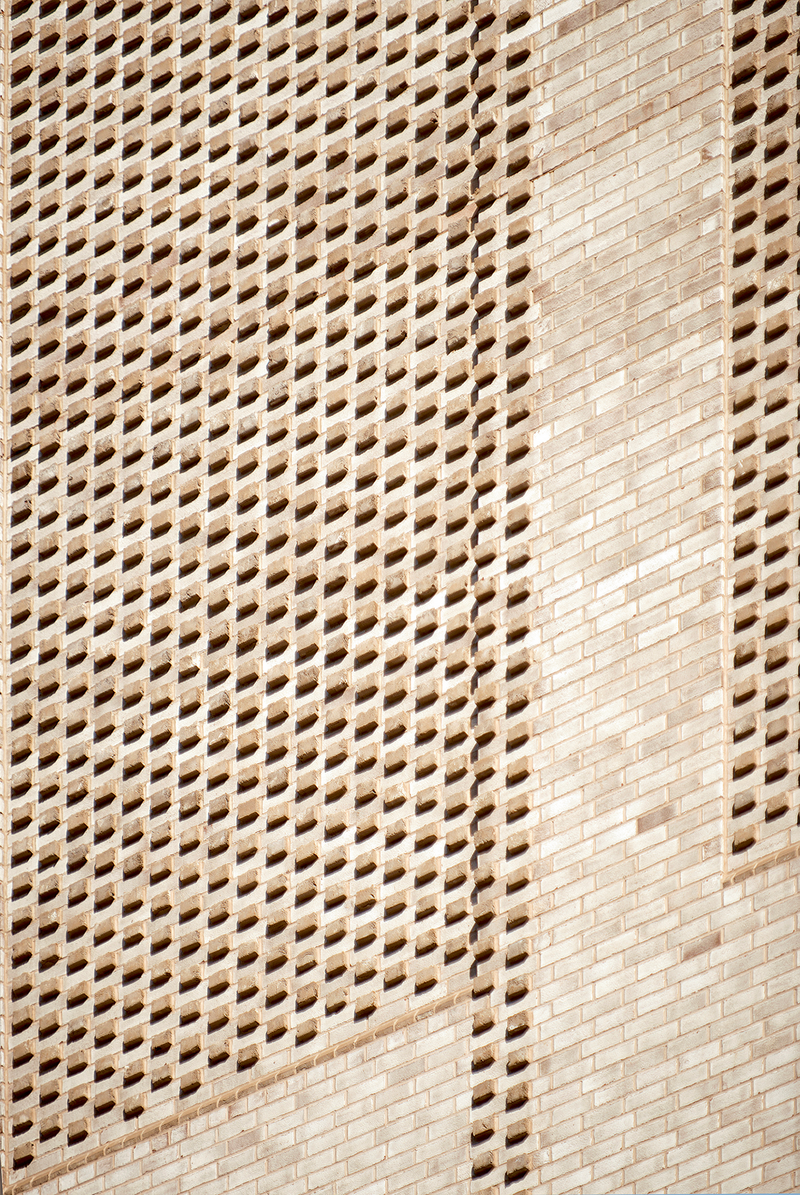 The top of the building incorporates a series projecting brick headers arranged in a square formation.