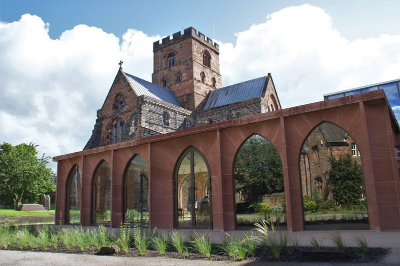 Feilden Fowles' red sandstone cafe pavilion at Carlisle Cathedral's medieval Fratry building.