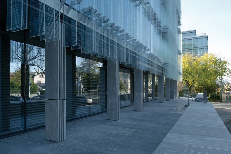 Vertical striations in glass are emulated  in the cladding of the steel colonnade at ground level.
