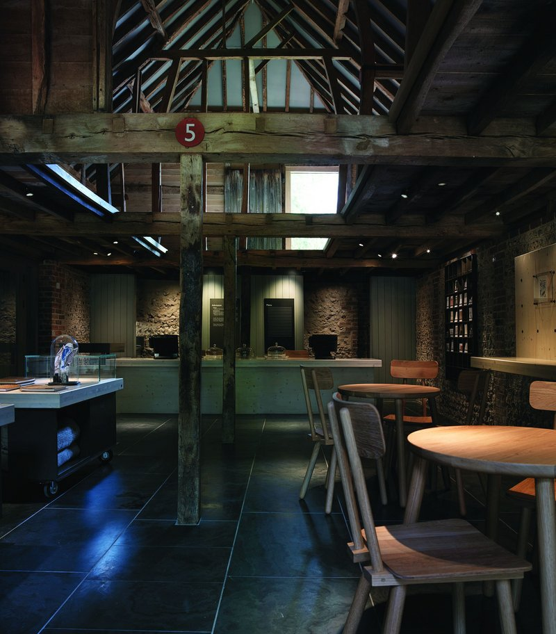 Inside the reused cart lodge: café, shop and ticketing.