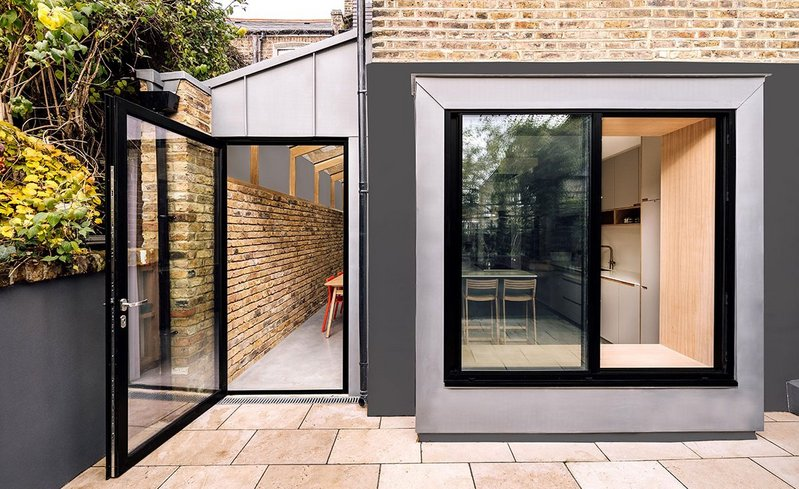 The Stoke Newington kitchen extension: 'We requested something modern and more creative than the standard side returns you see in the area,' say the clients. 'We now have a raised window with seat, oak beams, polished concrete and exposed brick.'