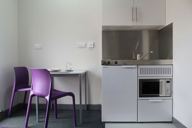 Elfin's Economy Plus at Poulson House student accommodation in Stoke: cooking, refrigerating, washing and storage in a single space-saving design.