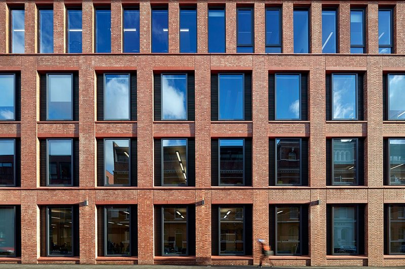 Detailing of the brick slips gives the facade a handmade feel.