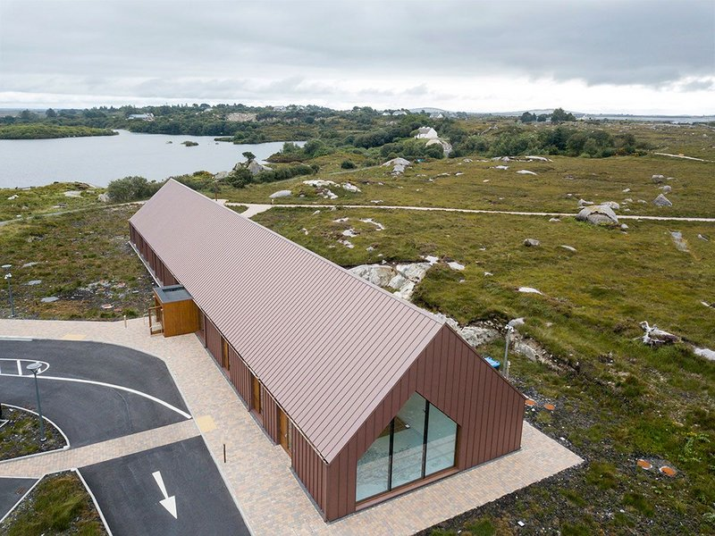 Pigmento Red Plus zinc standing seam roofing and cladding at the Pearse Cottage Visitors Centre, County Galway. Simon J Kelly Architects.
