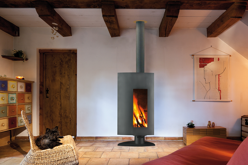 Stofocus Pivoting steel wood stove with triple-layered insulation and heat-resistant materials covering the entire inner surface of the firebox. The large, off-centre Pyroceramic glass screen is set in a curved facade and a side door opens to allow wood to be loaded.