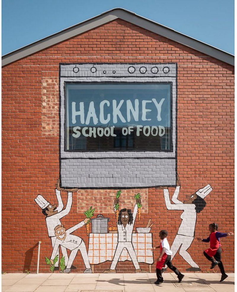 Hackney School of Food, designed by Surman Weston in Hackney, north east London. The mural gives the community building a clear public presence.