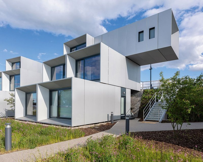 At the Dyson Institute in Wiltshire cantilevers of 3m for each storey give a strong overall shape to the student residences against the green bund.