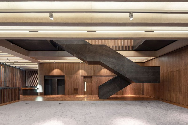 Concrete soffits, board-marked concrete, concrete screed floor and waxed steel: it's a far cry from the Royal College of Pathologists' former home in Carlton House Terrace.