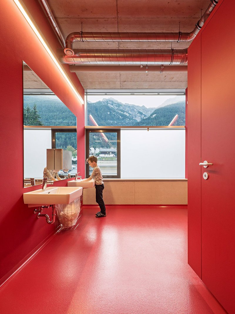 Light and mountain views are present throughout the building.