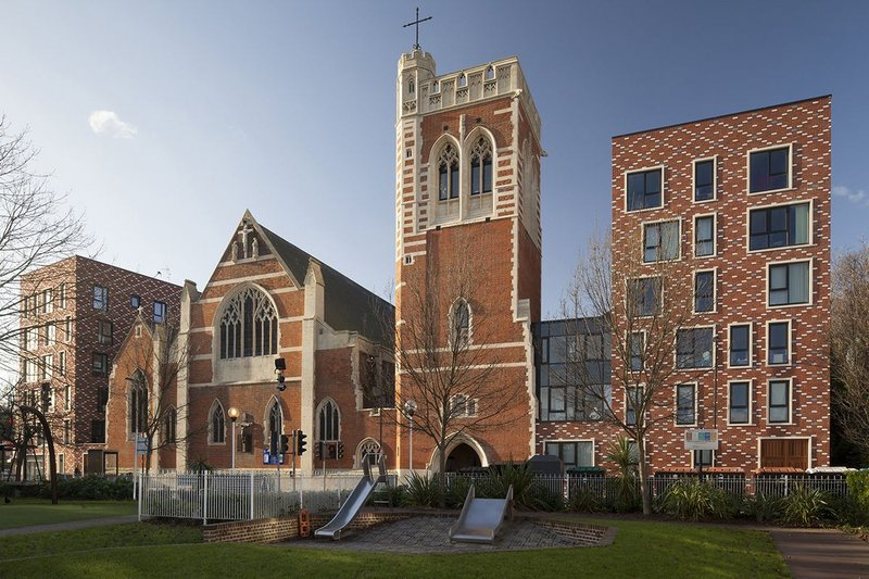 A solid presence:  St Mary of Eton in east London. The church remains at the centre, now flanked by two residential towers.