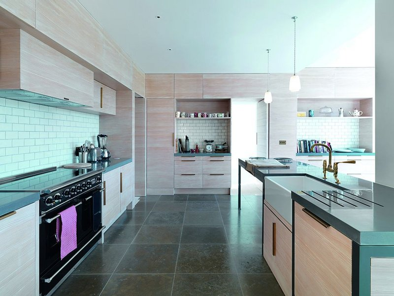 Pale grey tiles and pale Douglas fir  counterpoint the dark blue limestone floor