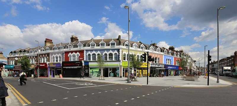 Could a new image help? It has in London's Walthamstow where a critical junction has been remodelled and Jan Kattein has worked on the signage and facades.