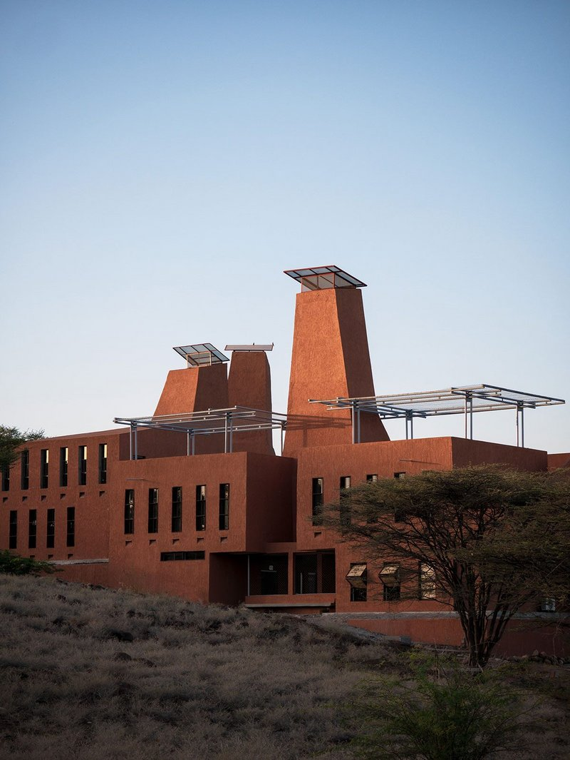 Startup Lions Campus is made of rock from the site it is built on. Creeping vegetation is intended to grow over light steel frames on the roofs.