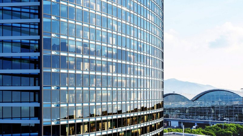 Curtain wall systems create light-filled commercial and residential spaces with panoramic views.