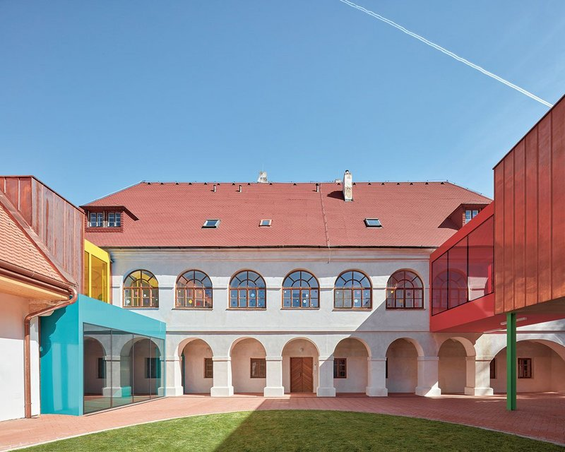 The courtyard has become the centre of things with playful new bridges that connect the main building with the wings behind.
