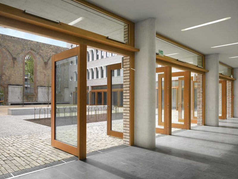 Large timber doors open directly onto the courtyard.