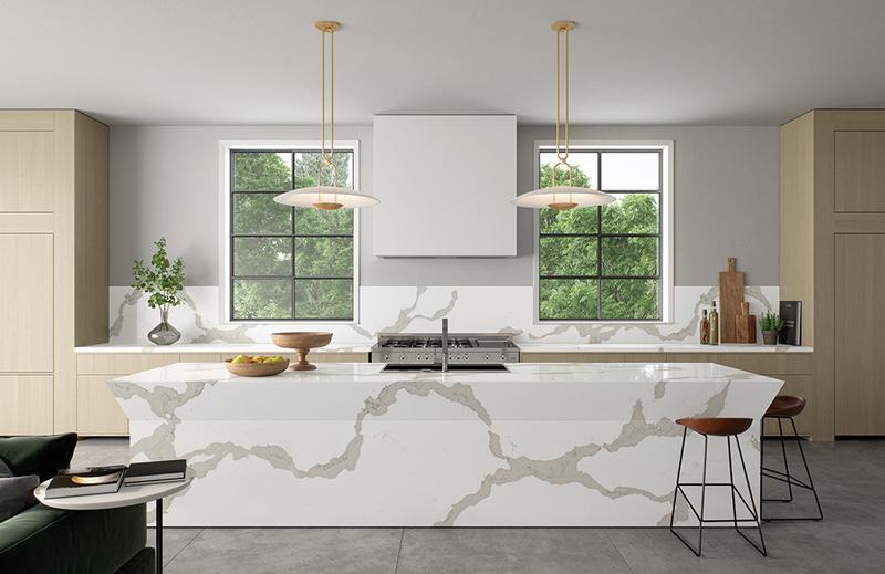 Kitchen splashback, worktop and island in 5114 Calacatta Maximus Caesarstone polished quartz.