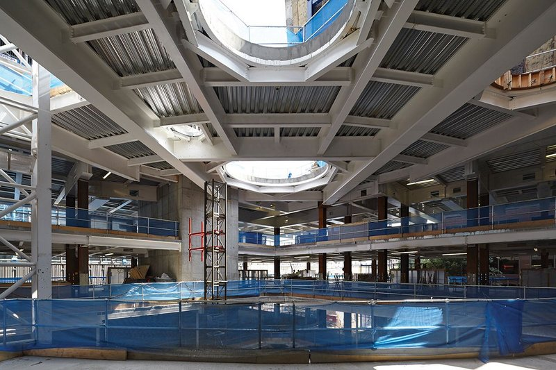 Sixth form college atrium, showing the steel structure of the third floor transfer deck.