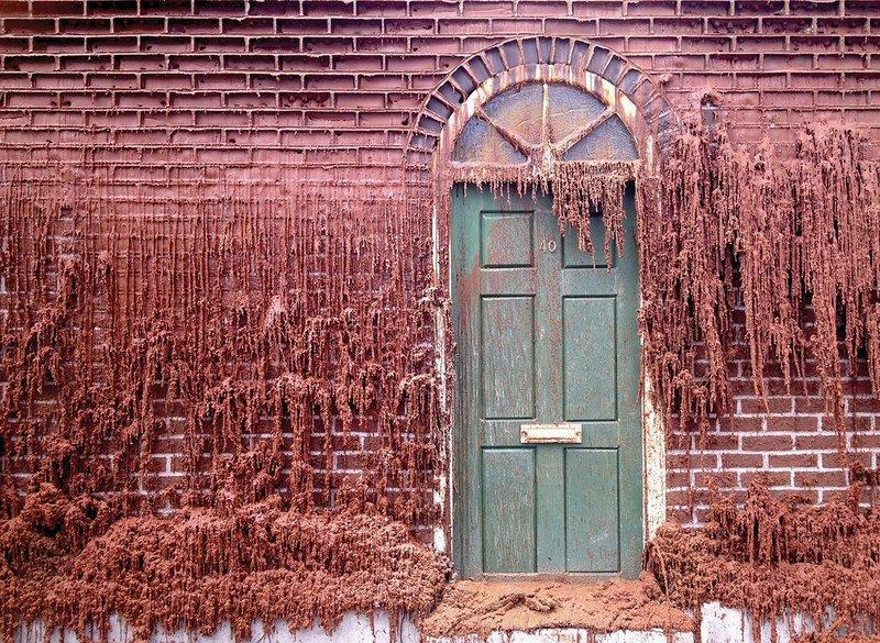 Wax bricks begin to feel the heat on the melting house.