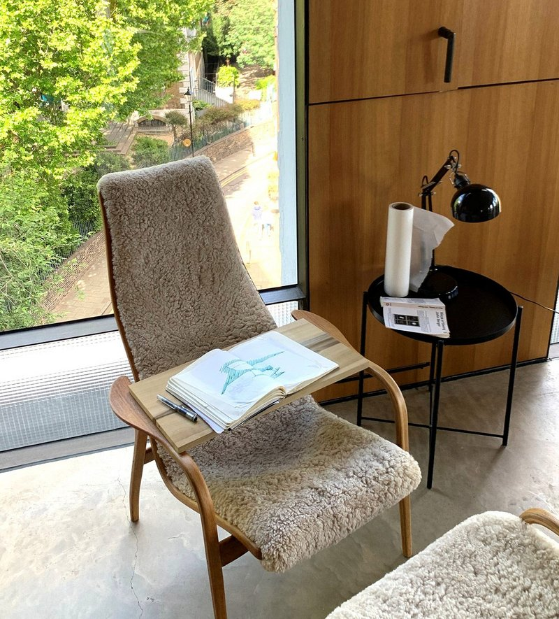 Refurbished 1956 Lamino chair by Yngve Ekström with Taha's sketchbook showing ideas for an Italian farmhouse project.