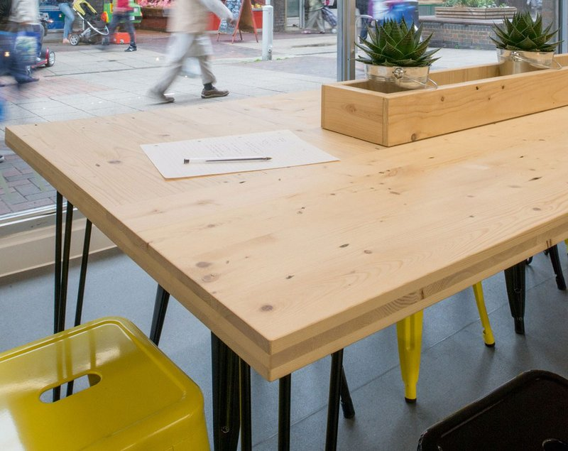 Prototype CLST panels in use as table tops at Poplar's Chrisp St Exchange co-working space.