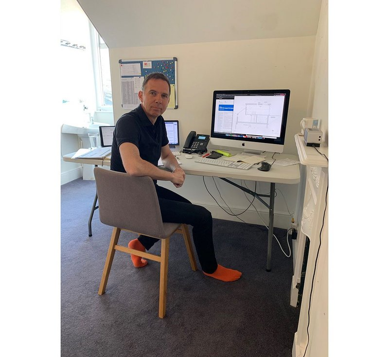 Mark Kemp of Place architects, working remotely in his home office.