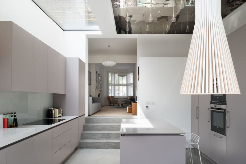 Flushglaze rooflights combine with large light fixtures to make the kitchen of this refurbished Victorian terrace an impressive space.