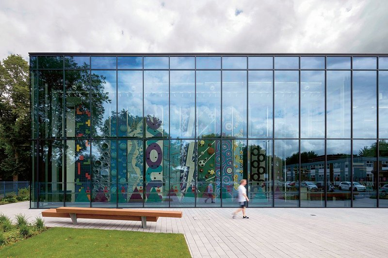 A new front section to the existing pool and sports hall is fronted up with a climbing wall.