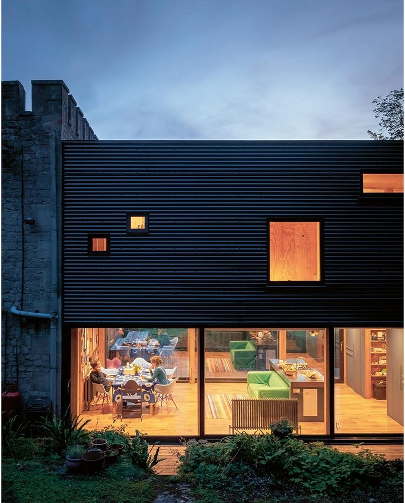 The clerestory and timber panelling of Taylor's original designs have gone from the north side of the house. The ground floor keeps its transparency.